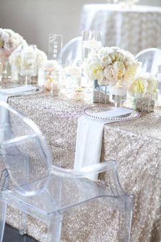 sparkly linens. candles. mirrored vase boxes. LOVE. click for the full gallery