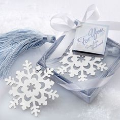 Our Snowflake Bookmark Holiday Party Favor makes a lovely favor at your winter wedding or holiday party. Gleaming, metal snowflake bookmark is highlighted by intricate openwork detail. Exquisite, ice-blue tassel captures the essence of winter.