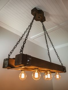 """""""The Double Barrel"""" beam chandelier is a welcome new addition to our growing family of beam chandeliers. Made from cedar beams that are 3 feet long, it includes hand bent metal straps and heavy Wooden Chandelier, Wooden Lamp, Industrial Style Lighting, Rustic Lighting, Light Fittings, Light Fixtures, Double Barrel, Wood Beams, Room Lights"""