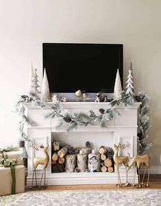 These ways to decorate a Christmas mantel with a TV above it are awesome! The fireplace mantel decorating ideas are so pretty, you don't even notice the TV!