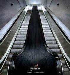 Pantene pro-V. Advertising silky hair. shiny silky hair run between two escalators