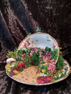 English garden teacup, this one was made to put in a fairy garden outside and was given several coats of clear coat to help it survive. All materials are available from Model Builders Supply (MBS), all you need is a teacup, cause let's face it, you're not using them for tea anymore.