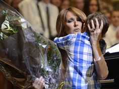 Celine Dion hugs a boy after he gave her flowers during a benefit for Ste-Justine's children's hospital in Montreal, Canada, on July 16, 2014