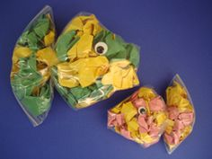 These are Fish Baggies - fish made from zip-lock baggies! If you can scrunch paper you can make this craft, a perfect ocean animal craft for toddlers and preschoolers!