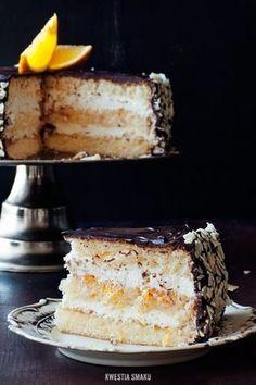 Tort Delicja II Puszysty biszkopt, pomarańcza i polewa czekoladowa.