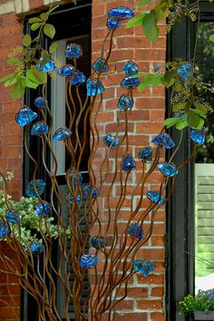 better than a bottle tree: chunks of glass encased in rusty wire