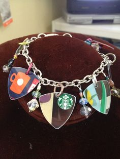 Recycled gift card guitar pick charm bracelet by RedRoosterJewelry
