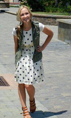 green utility vest, polka dot dress--love this concept.