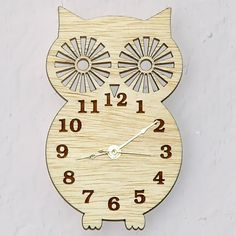 Owl Silhouette - Modern Wooden Wall Clock  with Natural Hand Rubbed Wax  Finish. $25.99, via Etsy.