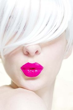 Luscious, glossy, shocking pink lips, platinum fringe.