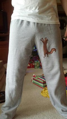 Sweat pants with a pesky squirrel after his nuts! A perfect gag gift for him!