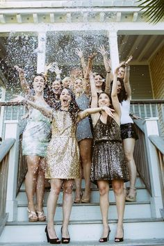 Bridesmaids and bride throwing glitter everywhere! So cute!!!!