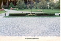 This photo displays a large paving stone driveway built with Nicolock Holland stone paver in Granite City, a gray blend that contrasts the glengarry Danish blend clay brick on the house facade. The driveway paver contrast and don't  clash with the reddish brown blend of the brick veneers. The entrance of the driveway was defined with two large columns and a extended wall on each site this also was built with clay bricks to match the house veneer. http://deckandpationaturalstones.com/?p=4168