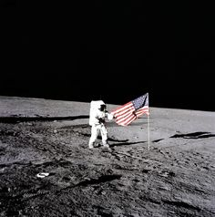 "November 19, 1969: Apollo 12 astronaut Charles ""Pete"" Conrad plants the U.S. flag on the lunar surface. Photo credit: NASA"