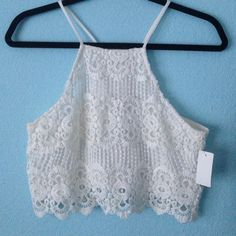 White lace crop top Never been worn. In perfect condition. Has a slip under so it's not see through. High necked and button in the back. Not from LF LF Tops