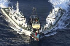 Japanese coast guard vessels block a protest boat Wednesday after activists from Hong Kong landed on disputed Uotsuri Island in the East China Sea. Regional tensions flared as the activists landed on the island claimed by Japan, China and Taiwan. Cost Guard, Chinese Boat, Coast Guard Ships, Vietnam, Hongkong, Navy Ships, Battleship, Sailing, China