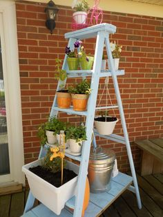 Keep your favorite herbs close at hand with this tiered garden that even has space for a hanging planter.