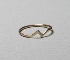 Gold Bolt Ring  This would be a unique engagement ring. And very simple.