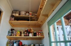 shelves above the pantry door to maximize space, high enough to not be in the way. could put seasonal dishes there.