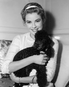 gracefilm:  31 Day Grace Challenge: Day 19| Favorite picture of Grace with a canine friend Grace  Oliver on the set of The Swan.