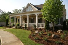 Front yard landscaping that reduces the use of grass.  Niche Gardens Landscaping, Inc.