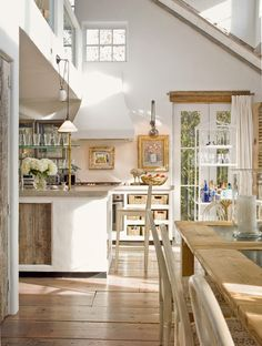 Cottage Kitchen with French doors, Exposed beam, Elmwood Reclaimed Grey Barn Wood Paneling, Pendant light, Kitchen island