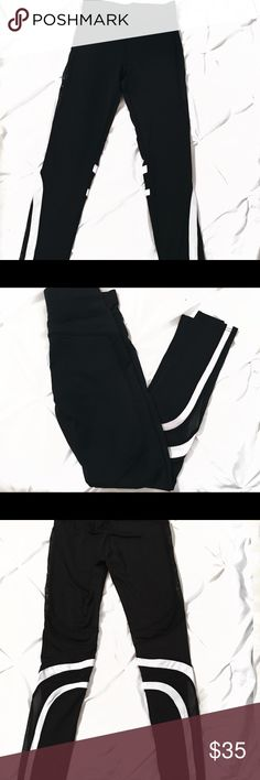 Badgley Mischka Sport Leggings Brand New without tags! Black & white leggings with mesh panels on side. Badgley Mischka Other