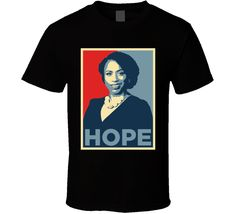 Ayanna Pressley Us Democratic Political T Shirt is available on a Black Cotton Tee. The Ayanna Pressley Us Democratic Political T Shirt is available in all sizes which you can select from the shirt size drop down below Badass Style, Pin Image, Cotton Tee, Cool Designs, Politics, Group, Tees, Board, Mens Tops