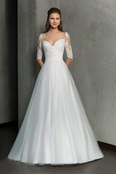 Elegant and romantic describes this classic luxurious Tulle, A-line gown featuring a ruched bodice with Sweetheart neckline and magnificent, lace over illusion length sleeves. The sexy low back features a button closure. Wedding Dress Pictures, Rustic Wedding Dresses, Wedding Dress Trends, Wedding Dress Styles, Bridal Dresses, Bridesmaid Dresses, Ivory Wedding, Elegant Wedding, V Neck Wedding Dress