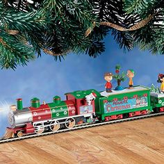 The PEANUTS Christmas Express Electric Train Set by Hawthorne Village:   No one captures the true spirit and joy of the Christmas season better than the PEANUTS Gang! Now you can join Charlie Brown, Snoopy, Lucy and the rest of your favorite characters aboard the PEANUTS train collection. This heartfelt train set includes the Snoopy Steam Locomotive, the PEANUTS Christmas Coal Car with Charlie Brown and Linus figure, and Caroling at the Tree Gondola Car. Plus you will receive a FREE 14...