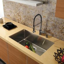 View the Vigo VG15021 Elongated Single Bowl 16 Gauge Stainless Steel Kitchen Sink (VGR3219C) and Single Handle Pull-Down Spray Kitchen Faucet with Soap Dispenser (VG02013) at FaucetDirect.com. $509.30