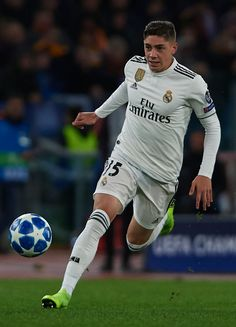 Federico Valverde of Real Madrid runs with the ball during the Group G match of the UEFA Champions League between AS Roma and Real Madrid at Stadio Olimpico on November 2018 in Rome, Italy. Get premium, high resolution news photos at Getty Images Logo Del Real Madrid, Real Madrid Barcelona, Ramos Real Madrid, Real Madrid Club, Madrid Girl, Fiesta Real Madrid, Real Madrid Football, Cristiano Ronaldo Wallpapers, Uruguay