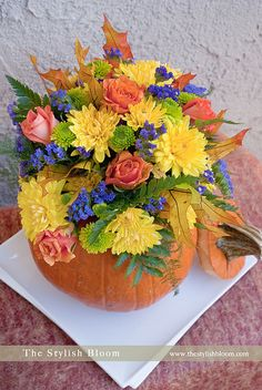 Fall flowers in pumpkin container