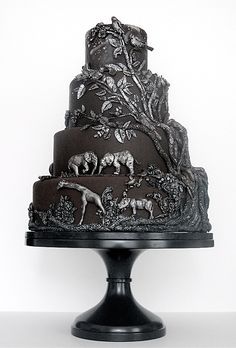 Brides.com: 22 Wedding Cakes for Dark, Modern Color Palettes. A Safari-Inspired Wedding Cake. We can't get over the detailing on Maggie Austin Cake's safari design. The silver-on-black effect is so incredible, you may not want to cut into it at all! See more whimsical wedding cakes.