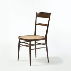 "Joaquim Tenreiro, Brazil, 1942 Set of eight ""First Chairs"" with jacaranda frame and cane seat.  20"" L x 17.5"" W x 33.5"" H  /  50.80cm L x 44.45cm W x 85.09cm H CH656"