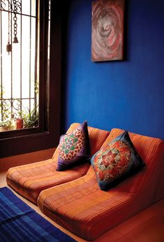 Beautiful colors in an Indian home, a nook with a great window and lots of Indian color and crafts