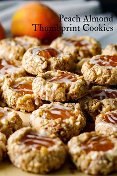 These buttery melt-in-your-mouth almond thumbprint cookies filled with peach preserves & drizzled with almond glaze are positively addicting. #thumbprintcookies #fruit #dessert #cookies #shortbread #almond | ofbatteranddough.com