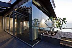 Masculine Dark Modern Tropical Penthouse Apartment