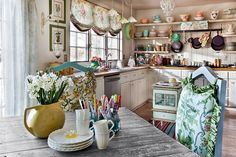 Flea market finds combined with beautiful layout and open shelving creates a gorgeous kitchen 50 Fabulous Shabby Chic Kitchens That Bowl You Over!
