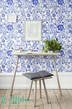 DESCRIPTION Transform any room in your home into a rose paradise with this adhesive wallpaper! This vinyl wallpaper features a blue print of floral wall decals. Blue flowers are paired with blue leave