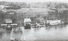 Overall view of the RAF Killadeas the 131 OTU (Operational Training Unit) Base at with Catalina's moored alongside and being attended to under cover of the 'sheds'. Lough Erne, near Enniskillen, Co Fermanagh.