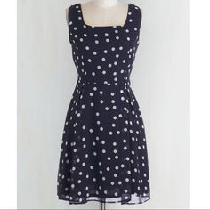 Yellow Star polka dot dress from Modcloth Sweet and breezy navy dress with white polka dots. Pleated at waist. Fully lined and has a sashed tie waist.  Like new condition. Yellow Star Dresses