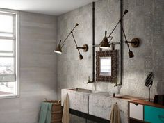 The two walls and sink here, tiled in Kronos by Saloni Ceramica, look like they are made of embossed concrete.