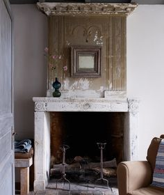 Beat up yet classic- this fireplace is so beautiful.