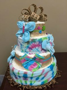 Peace, Love, Baby! Tie dye diaper cake, shower gift. Baby girl shower. More photos on my Facebook page,  Simply Showers.  http://m.me/adorablegifts