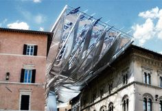 Austrian architects Coop Himmelb(l)au have designed an energy-generating canopy for a passageway in Perugia, Italy. Futuristic Architecture, School Architecture, Contemporary Architecture, Architecture Design, Italy Architecture, Chinese Architecture, Parasitic Architecture, Building Skin, Solar Power
