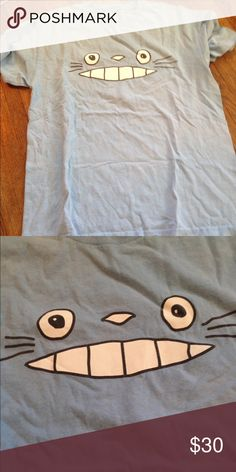 Light blue Totoro tshirt!! This was purchased at an anime convention! I've never worn it, it has no holes or stains! It's in great condition! It has no tags but it is a large. It comes from a smoke free environment! I don't hold or trade! Please don't negotiate the price in the comments! I only sell through poshmark! Not from hot topic just listed for views. Hot Topic Tops Tees - Short Sleeve