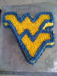 I am thinking my sister will have me a cake like this for my b-day....or any day (just for being a great sister)!! Go WVU!!
