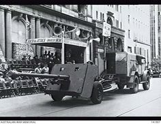 An Australian made anti-tank gun being towed along a city street during the Miles of Munitions Parade through the city. Navy Air Force, Ww2 Pictures, Ww2 Tanks, Army & Navy, City Streets, World War, Melbourne, Guns, Korea