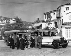 1928: Passengers are seen boarding busses for a real estate promotional tour in the Hollywoodland Tract